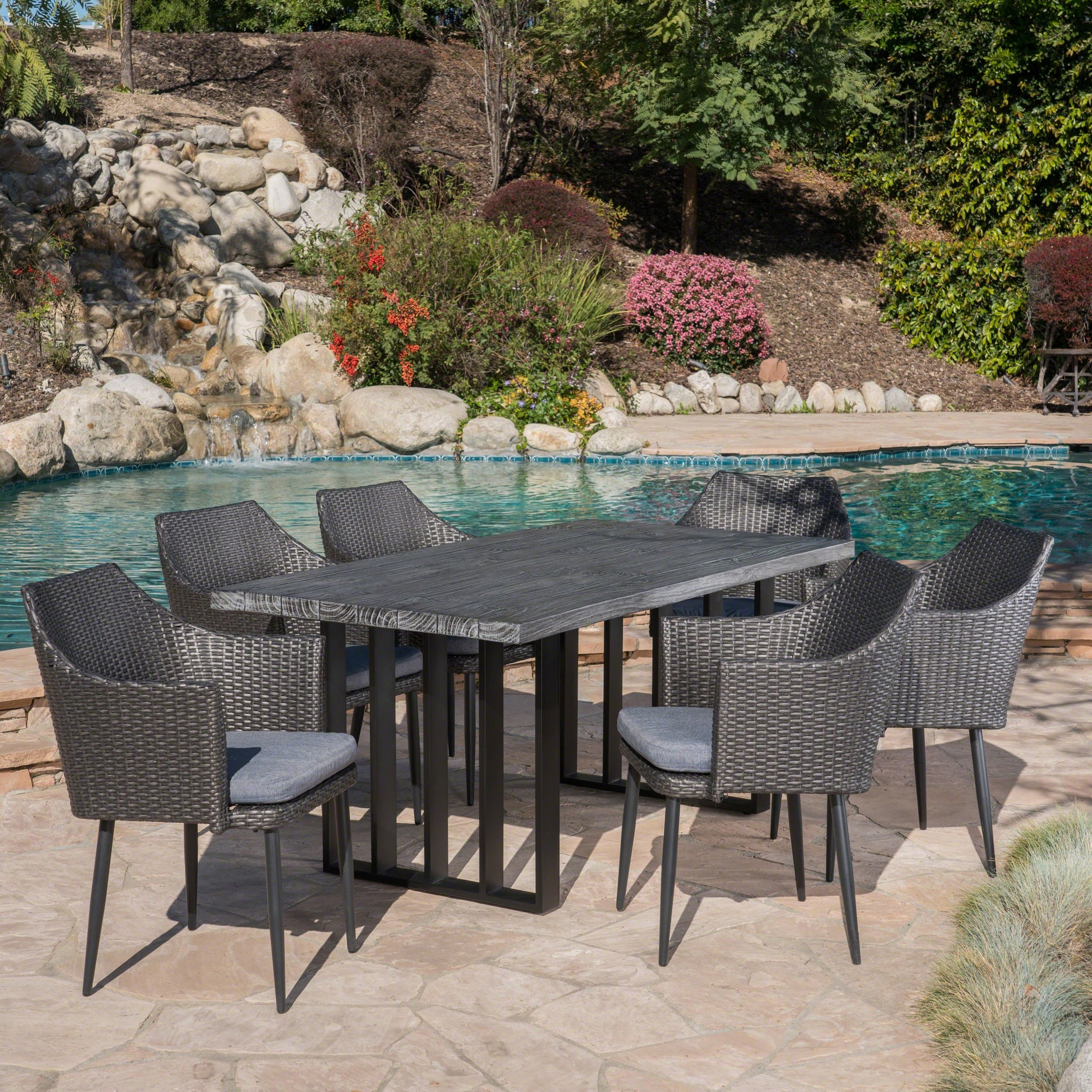 Metropol Outdoor 7 Piece Wicker Dining Set With Finish Concrete Dining Table And Water Resistant Cushions