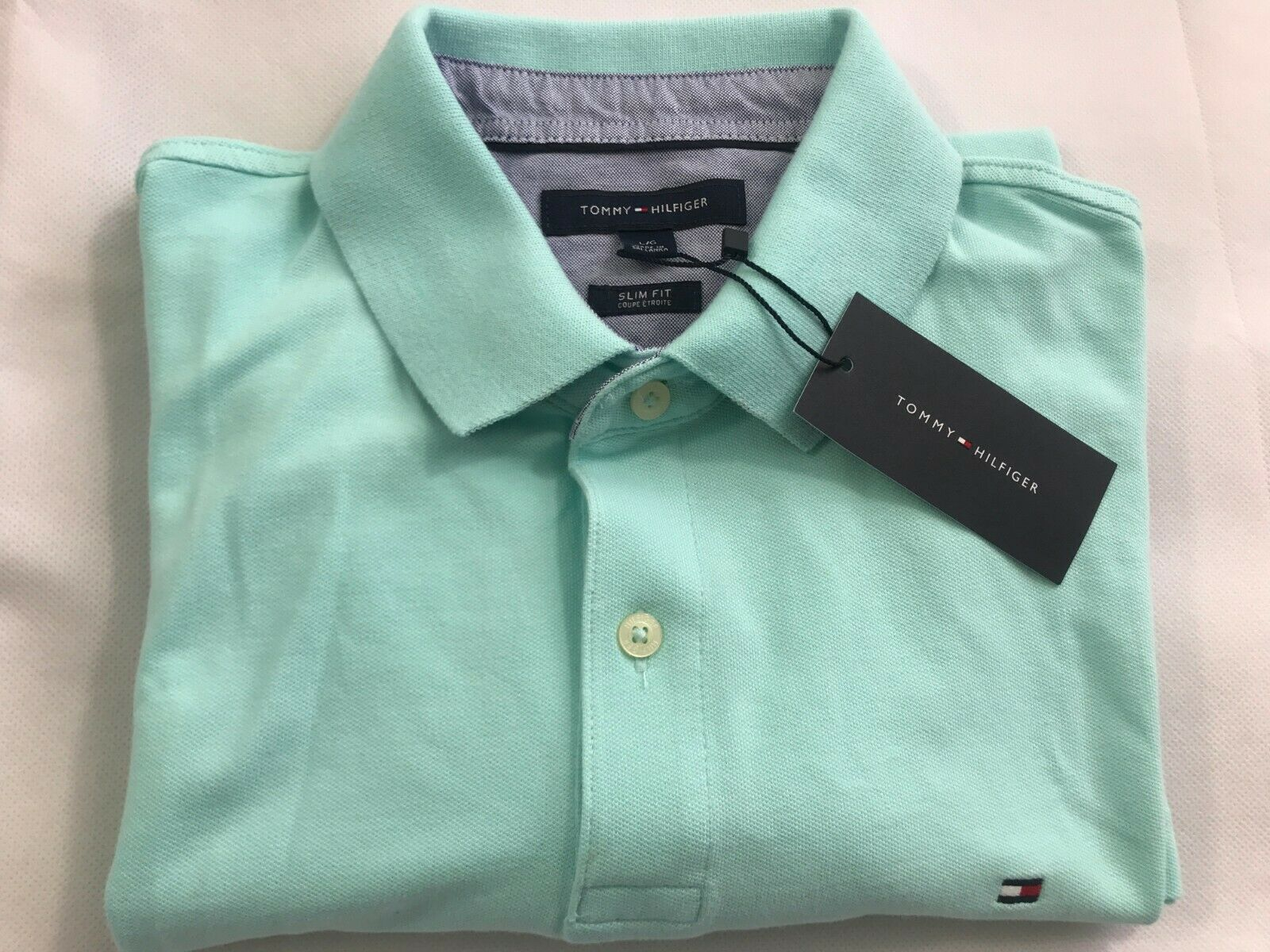 f05a4a5671 Mens Tommy Hilfiger Slim Classic Aqua Blue Limpet Sea Shell Polo Shirt –  Snatch A Bargain 24/7