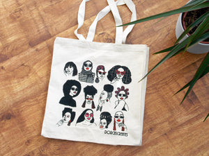 Black Canvas Tote Bag screen printed with white illustration of black man wearing sunglasses and hats