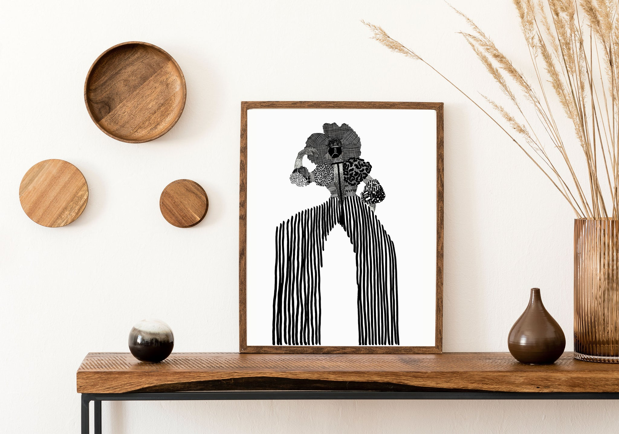 Framed We Were Here Ancestral Illustration by Black Artist DorcasCreates Sitting on an Oak table