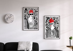 Two art prints framed in living room; illustration of african man and african woman by DorcasCreates