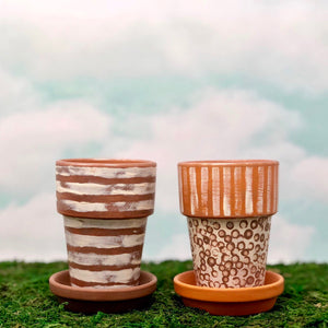 Handpainted Afrocentric Terracotta Pots with a distressed motif of lines and dots.