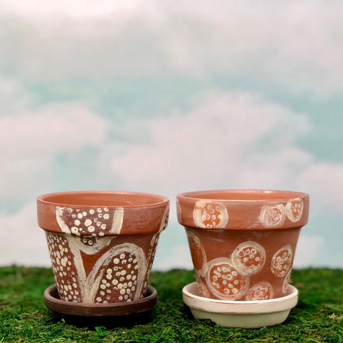 Handpainted Afrocentric Terracotta Pots with a distressed tribal design.