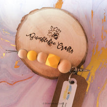 Load image into Gallery viewer, Silver Tone Silicone Bead Keyring with raw wood - Bumblebee Crafts