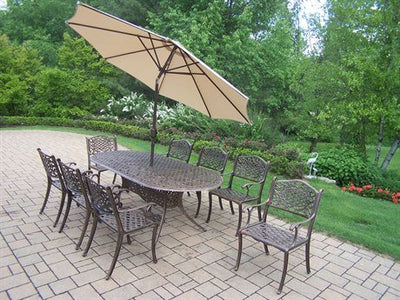 Oakland Living Mississippi 11-Piece Dining Set with 84 by 42-Inch Oval Table, 8 Chairs, 9-Feet Tilt and Crank Beige Umbrella and Stand