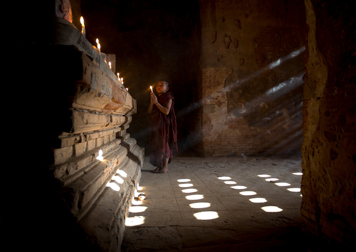 Young Monk Praying At A Temple In Bagan- Myanmar.