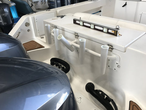 Install your rod holder when the outboard motor is down