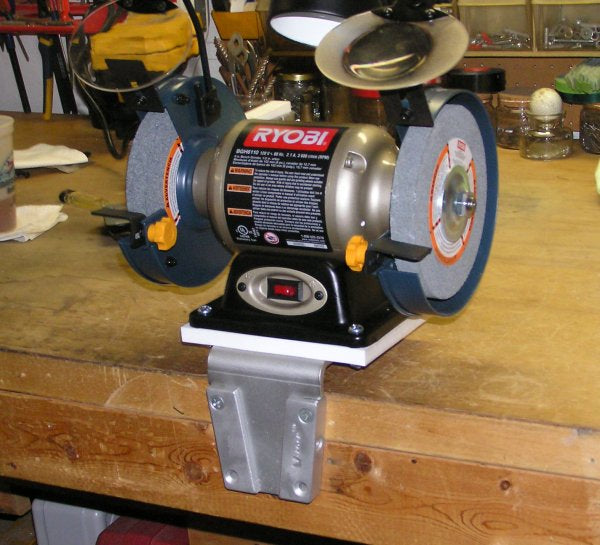 Attach a grinder to the work bench
