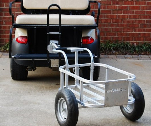 Golf cart pulling a utility cart using V-Lock