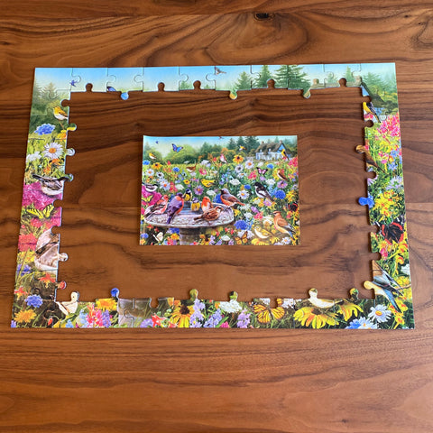 100XXL The Secret Garden jigsaw puzzle with border pieces pieced together and the image of the artwork in the middle
