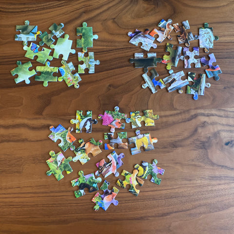 Three groups of jigsaw puzzle pieces, each group a similar colour