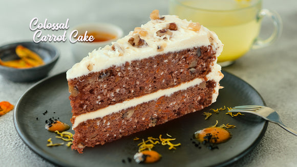 Slice of Wow Factor Colossal Carrot Cake on a plate