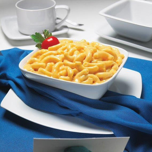 Campbells Deluxe Macaroni and Cheese cooked in a white bowl with a blue napkin underneath