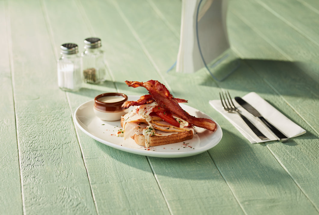 Image of a piece of Ready Bake Texas Whole Wheat Bread on a plate with bacon and other toppings
