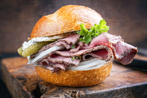 Prime rib sandwich with onions and pickles