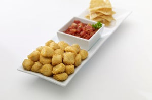 popcorn chicken with salsa on a white plate