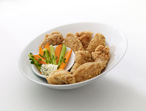 Nikolaos jumbo pub chicken wings in a bowl with celery and carrots
