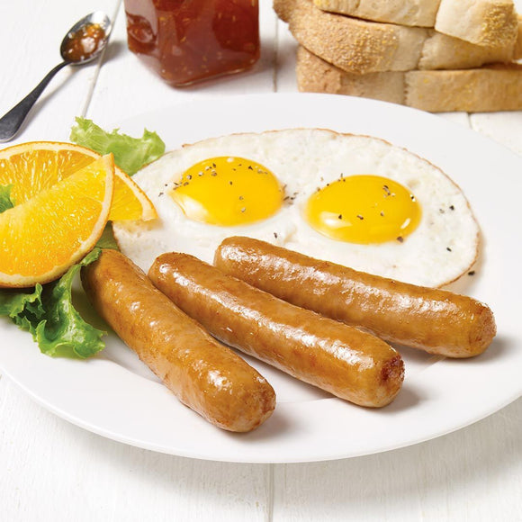 Olymel breakfast sausage on a plate next to eggs and orange slices