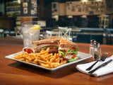 Cavendish French fries on a plate with a clubhouse sandwich
