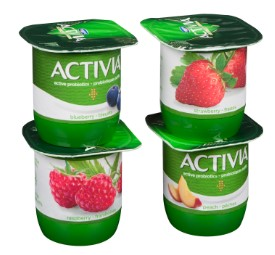 Four cups of Activia yogurt in blueberry, strawberry, raspberry, peach flavours