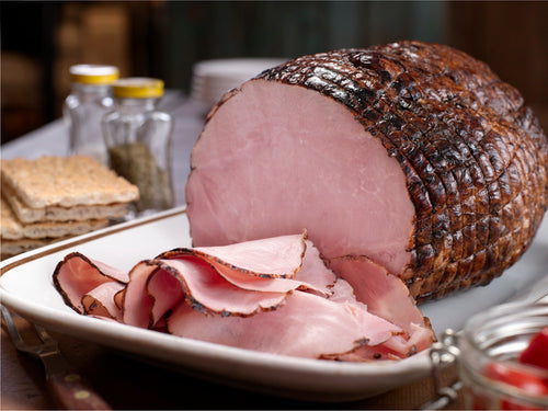 Maple Leaf Black Forest Ham sliced and served on a tray