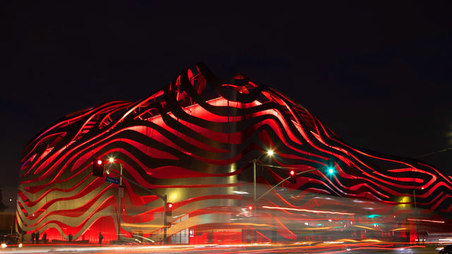 Elevation view at night of the Pedersen Automotive Museum in Los Angeles, California