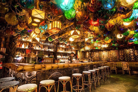 Image inside the False Idol Tiki with colorful lanterns hanging from the ceiling.