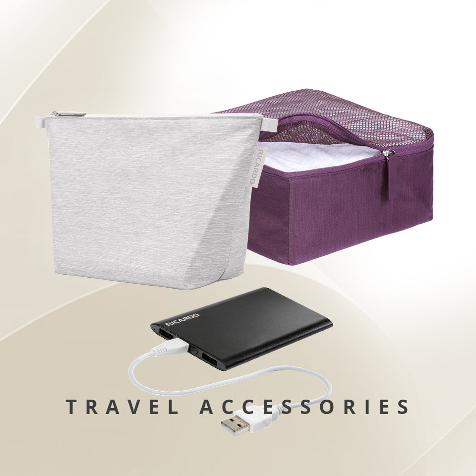 Battery/ Power bank, small toiletry bag in light grey and small packing cube in purple
