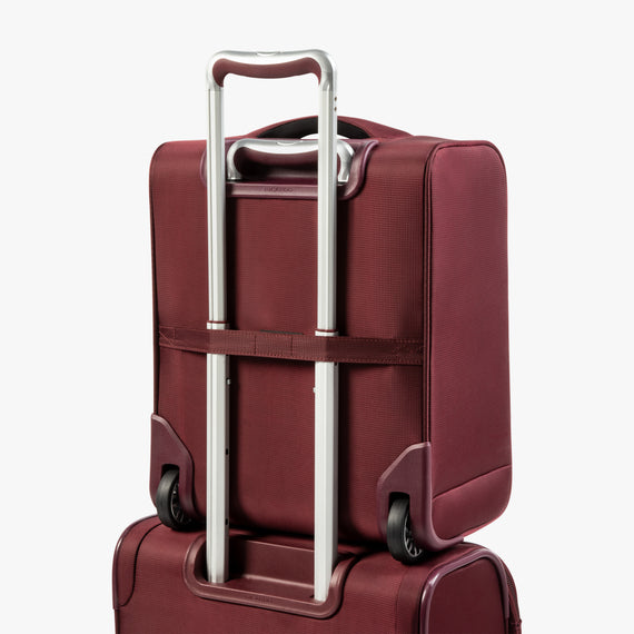Small Carry-On Seahaven 16-inch Rolling Tote in Currant Back Angle View in  in Color:Currant in  in Description:Back Angle
