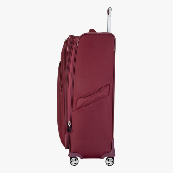 Large Check-in Seahaven 29-inch Check-In Suitcase in Currant Side View in  in Color:Currant in  in Description:Side