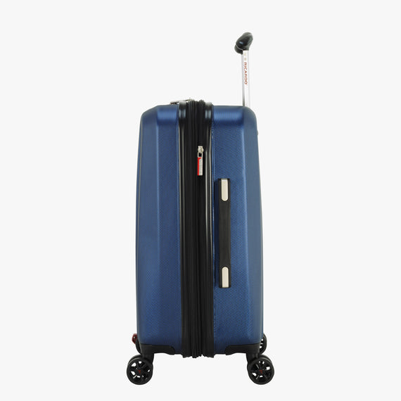 Carry-On San Clemente 21-Inch Carry-On Suitcase in Stellar Navy Side View in  in Color:Stellar Navy in  in Description:Side