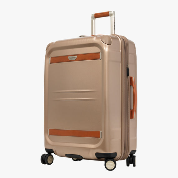 Medium Check-In Ocean Drive 25-inch Check-In Suitcase in Sandstone Front Quarter View in  in Color:Sandstone in  in Description:Angled View