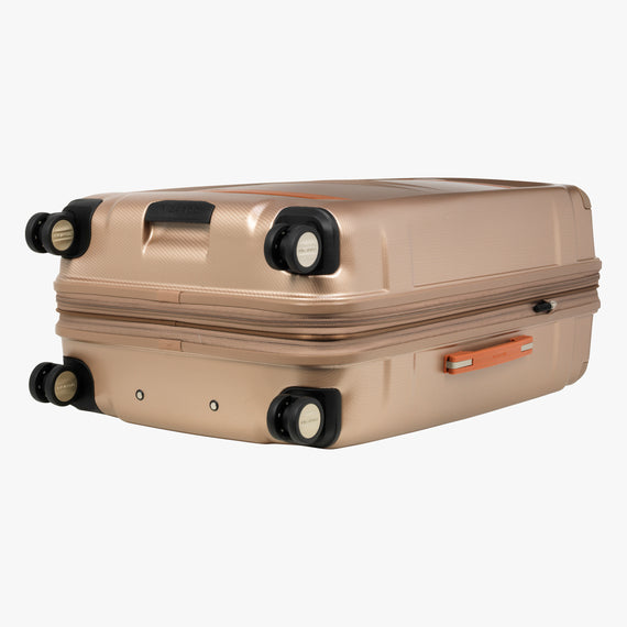 Large Check-In Ocean Drive 29-inch Check-In Suitcase in Sandstone Bottom View in  in Color:Sandstone in  in Description:Bottom
