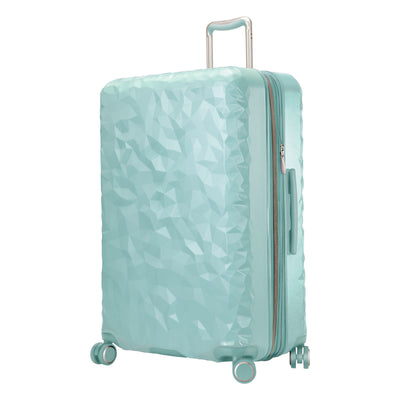mint green hardside suitcase with a textured surface and metallic accents