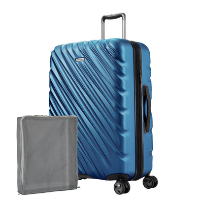 Twilight Blue Ricardo Mojave check-in hardside suitcase with diagonal grooves shown with a large grey packing cube
