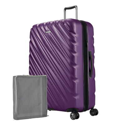 Aubergine purple Ricardo Mojave hardside suitcase with diagonal grooves shown with a large grey packing cube