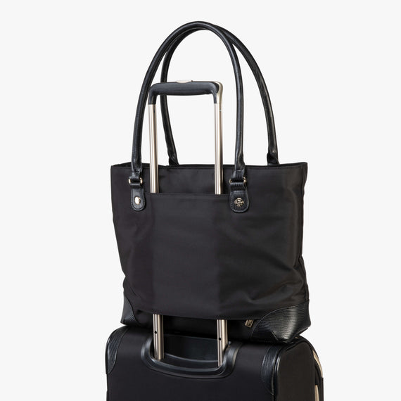 Travel Tote Manhattan Travel Tote in Black Feature View in  in Color:Black in  in Description:Backstrap