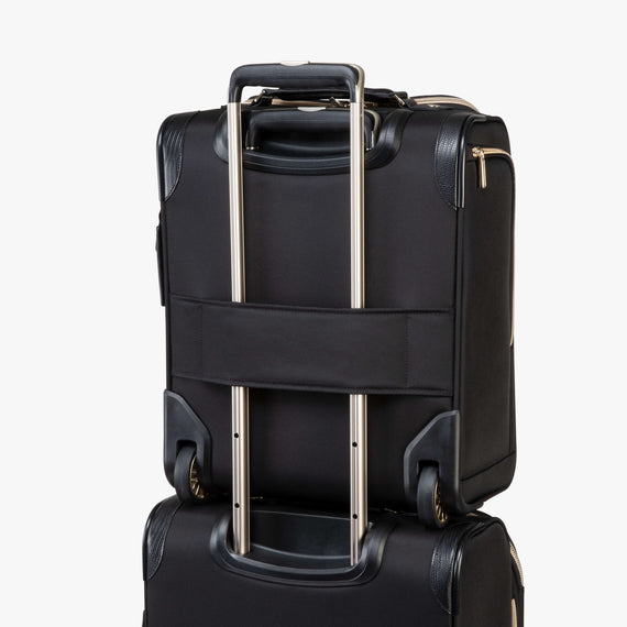 Small Carry-On Manhattan Under-Seat Carry-On in Black Feature View in  in Color:Black in  in Description:Backstrap