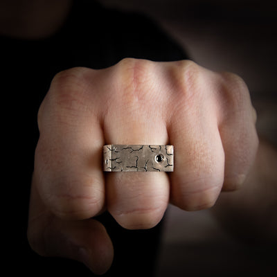 Silver, heavy ring with hand engraving and black diamonds on hand