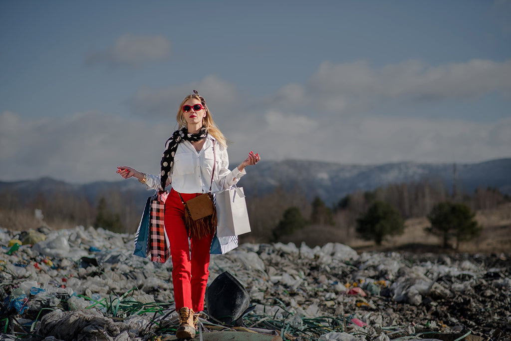 Person walking across landfill with shopping bags