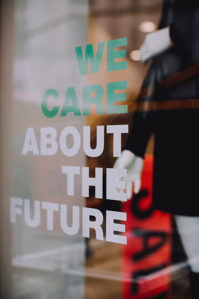 """Shop window with the words """"we care about the future"""""""