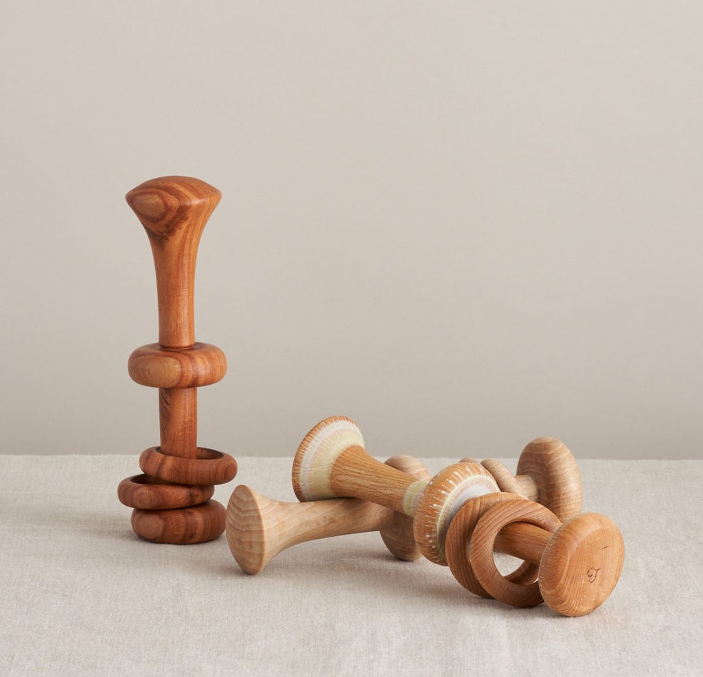 Wooden rattles made by Love Heartwood