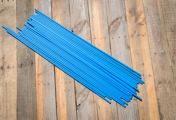 Stack of Bright Blue Driveway Markers for Snow