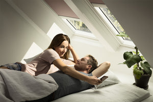 Couple using Velux ACTIVE control via smartphone app