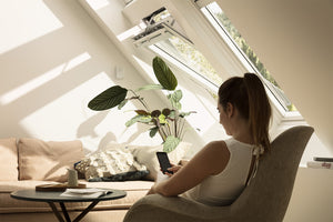 Person using Velux Active to adjust their skylights