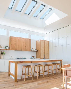 Modern oak kitchen turned into the brightest part of the house with the fixed skylights situated for the maximum sunlight