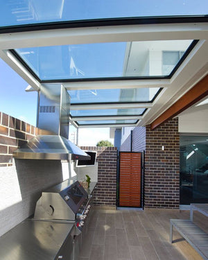 An enclosed BBQ area for a townhouse turn into undercover without the blocking of the sky. Skylights allow you to still feel like your outside when you're not