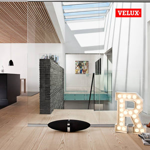 a hallway and kitchen using Velux fixed skylights