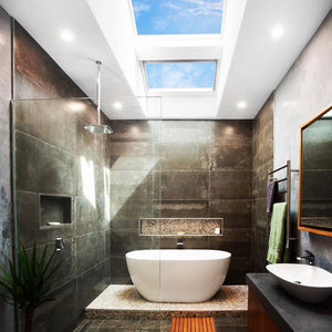 modern bathroom using skylights instead of typical windows for ventilation