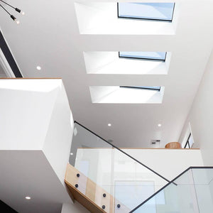 High ceilings taking advantage of the skylights to embrace the natural sunlight and starry night